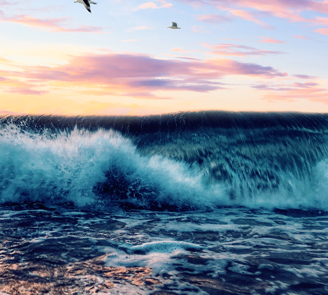 Waves Crashing At Sunset