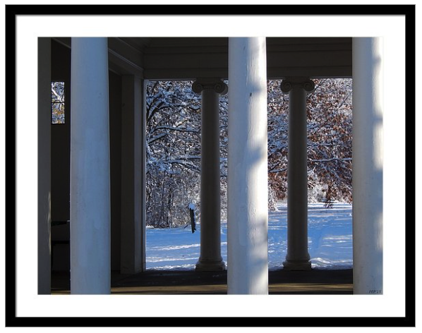Pillars And Snow Framed Print
