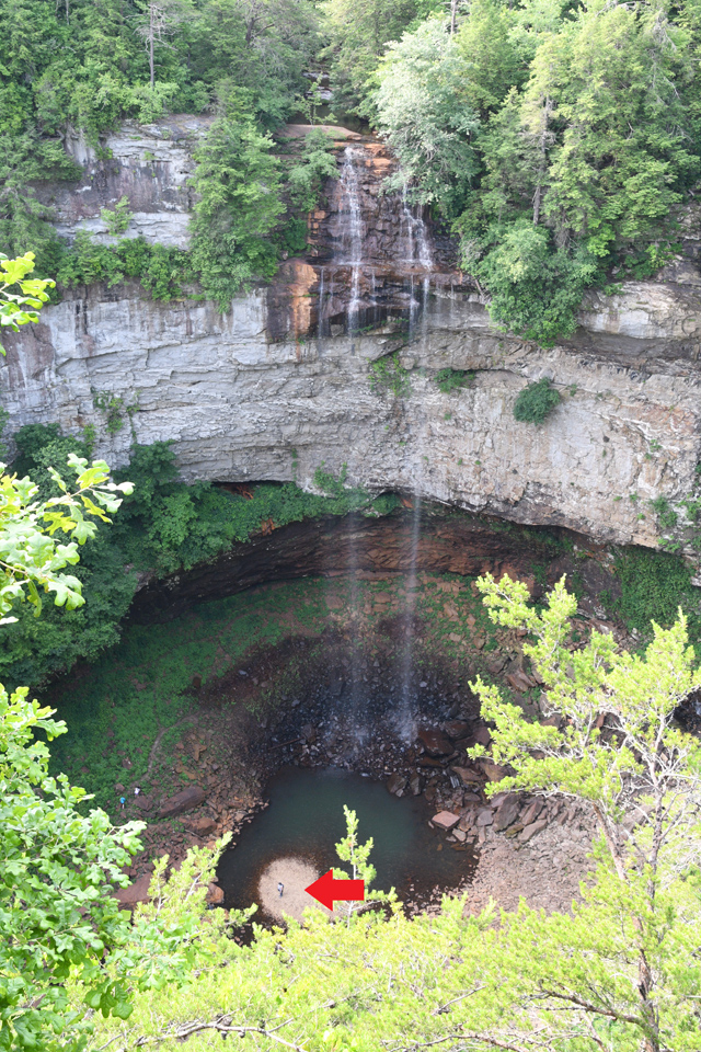 Three people visible at the base of Fall Creek Falls.